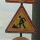 В Невском районе рабочие укладывали асфальт в лужи